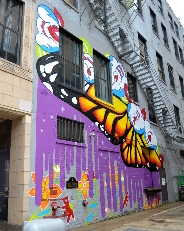 New south loop mural a gift from cirque du soleil for Chicago mural group